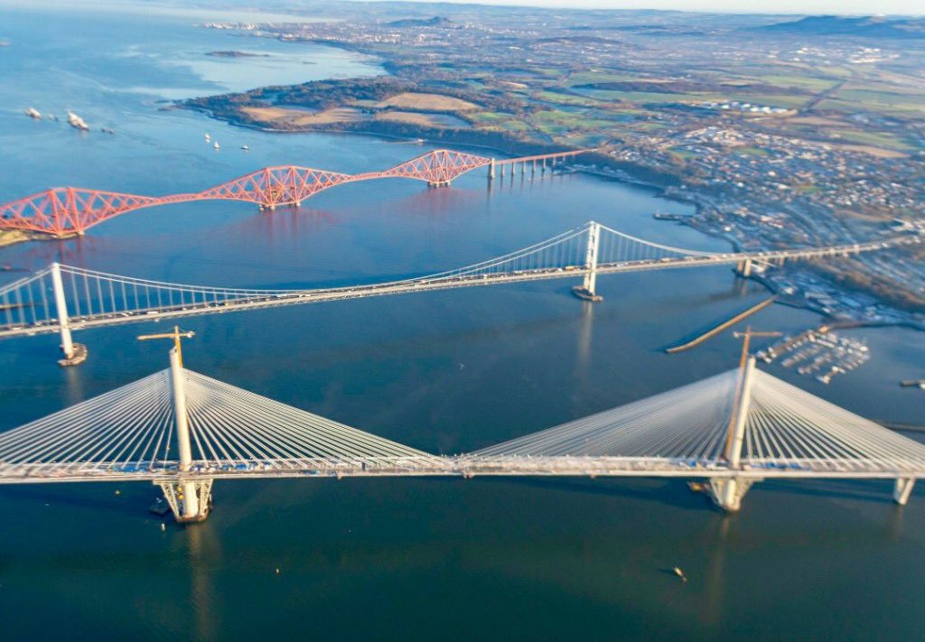 Ariel view of the three bridges over the Forth - Queensferry Crossing, Forth Road Bridge, and Forth (rail) Bridge