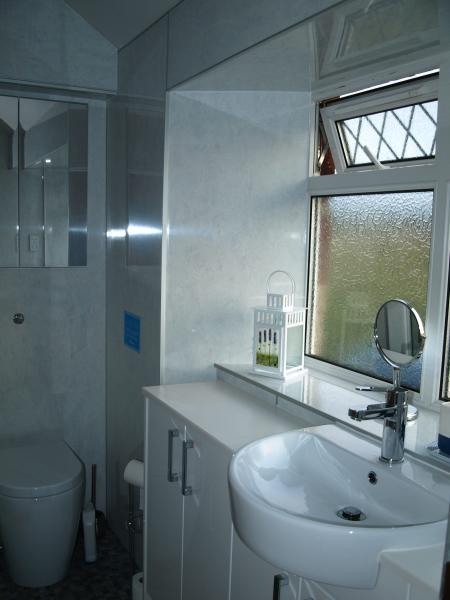 Bright and fresh bathroom with heated towel rail
